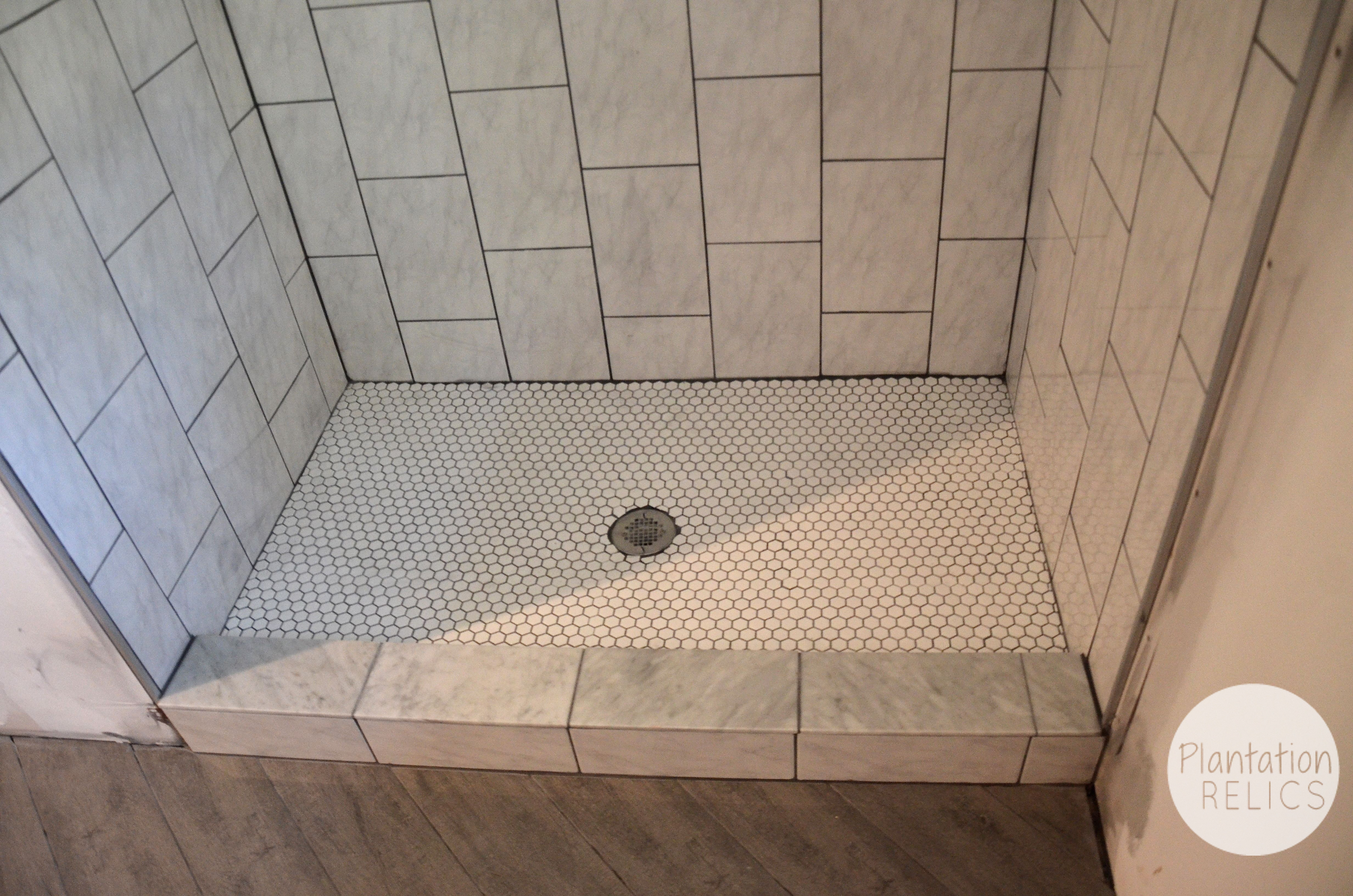 Hall bath tile design it 39 s quite the transformation for Bathroom floor tile ideas