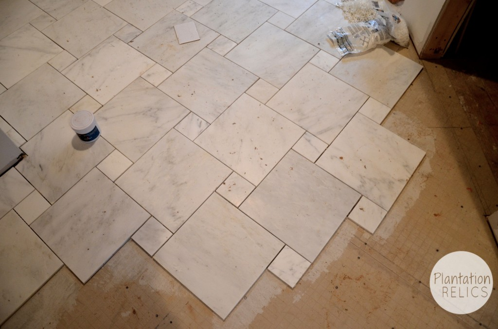 Carrara marble master bath flip house update for Master floor
