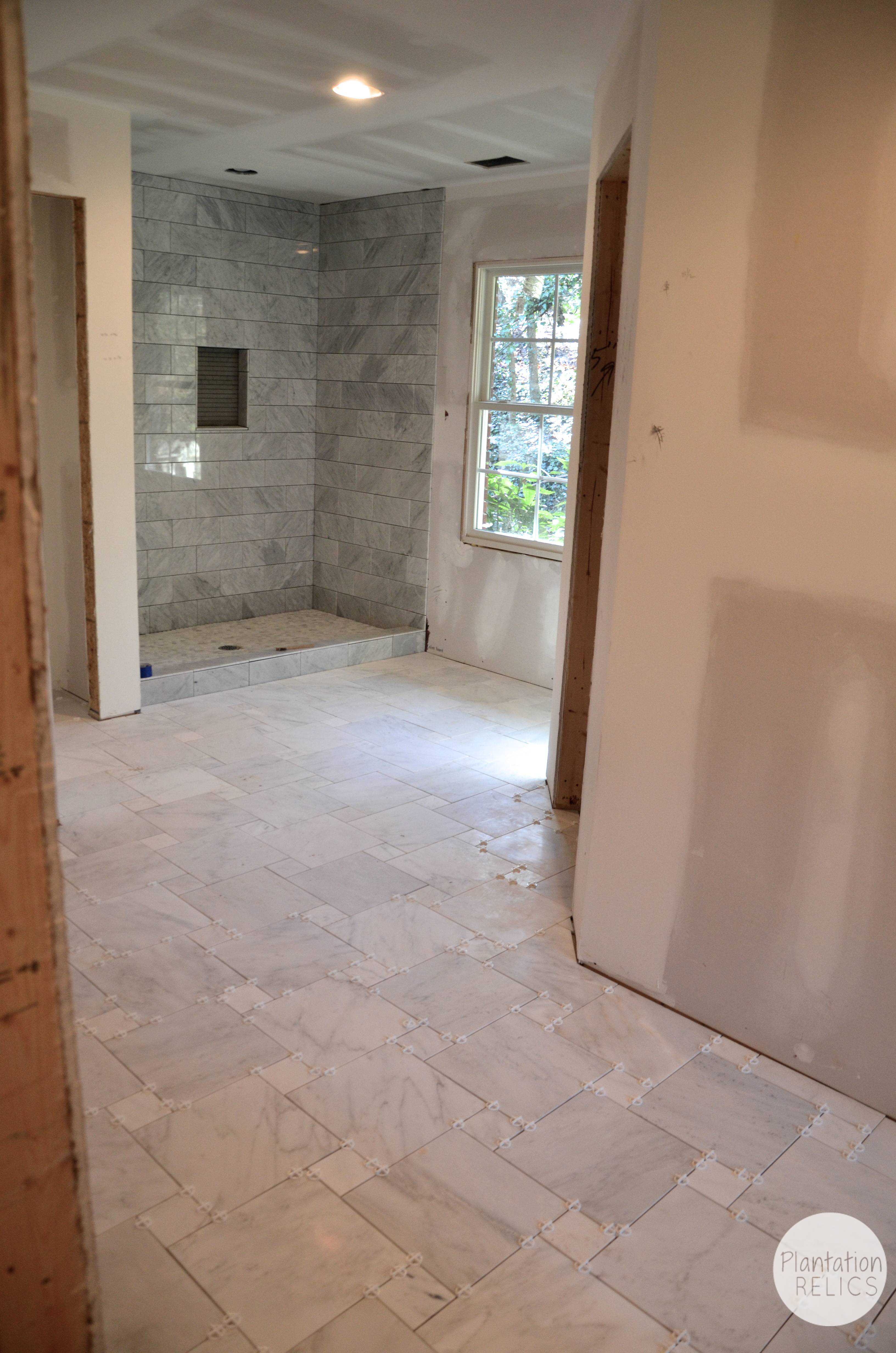 Carrara marble master bath flip house update for Marble master bathroom