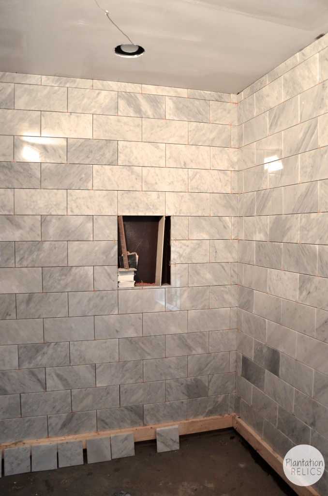 Carrara marble master bath flip house update for Masters wall tiles
